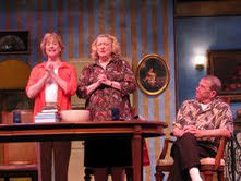 "Mary (Barbara Wilson) and Margaret (Gayle Grimes) recite the Catholic ""Profession of Faith"" before Father Murphy (Mark Yaeger). Photo courtesy of Reston Community Players."