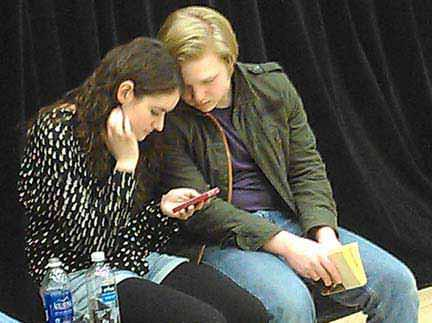 Catherine Callahan and Alex Sebastian Stone take a break during a rehearsal. Photo courtesy of McLean Community Players.