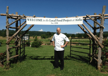 Airlie House Executive Chef Jeff Witte at the entrance to the kitchen gardens. Photo by Joran Wright.