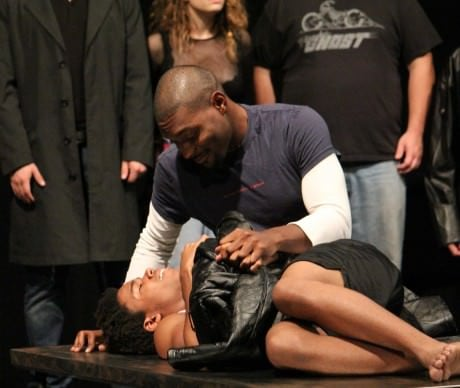 Jamar Brown (Tom Collins) comforts the ailing Angel (Malcolm Lewis). Photo courtesy of Silhouette Stages.
