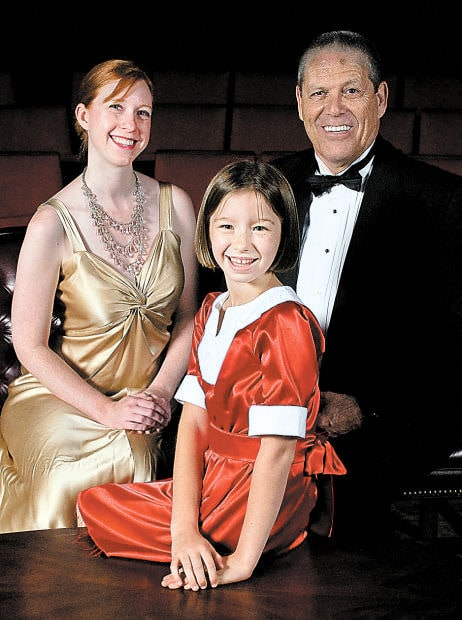 Grace (Kaelynn Miller), Annie (Daphne Eckman), and Daddy Warbucks (Timothy Sayles). Photo by Colburn Images.