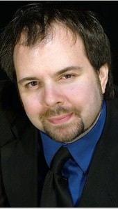 Andre L. Baughman.