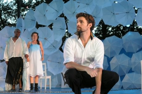 Prospero (Craig Wallace) and his daughter Miranda (Leah Filley) look on as Ferdinand (Alexander Korman) laments his father's fate in Olney Theatre Center's production of The Tempest (Photo: Stan Barouh)