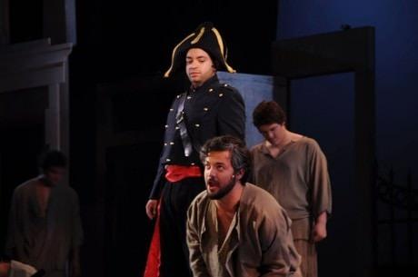 Javert (L- Renwick Anson Paige II) and Jean Valjean (JP Sisneros). Photo courtesy of Montgomery College Summer Dinner Theatre.