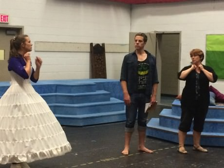 Director Carolyn Coulson rehearses with Anna (Jenna Pinchbeck) and The King (Russell Rinker).