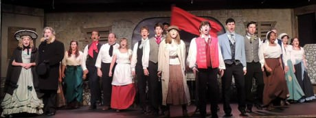 The cast of 'Les Misérables' singing 'One Day More.' Photo courtesy of Way Off Broadway Dinner Theatre.