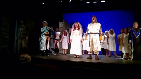 Stacy Crickmer (left as Lady of the Lake) and Jim Mitchell (right as King Arthur) and cast of Zemfira Stage's 'Monty Python's Spamalot.' Photo by Zina Bleck.