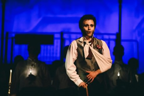 """Henry Cyr (Marius) singing """"Empty Chairs at Empty Tables."""" Photo by Kevin Gall."""