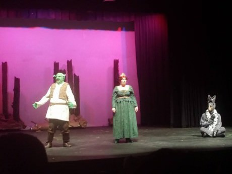 Glynn Cosker (Shrek), Jennifer LePaige (Fiona), and Devyn Tinker (Donkey).
