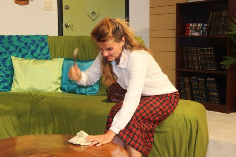 Kathryn Barrett-Gaines) (Clelia) smashing a plate. Photo courtesy of Parlor Room Theater.