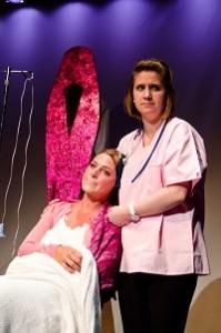 """Gracie Jones ( Chelsea) sitting sings the song """"A Nurse Named Desiree."""" Megan Westman (Desiree) is standing. Photo by Betty Adler."""
