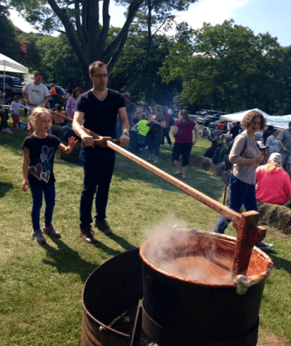 Stirring the apple butter.