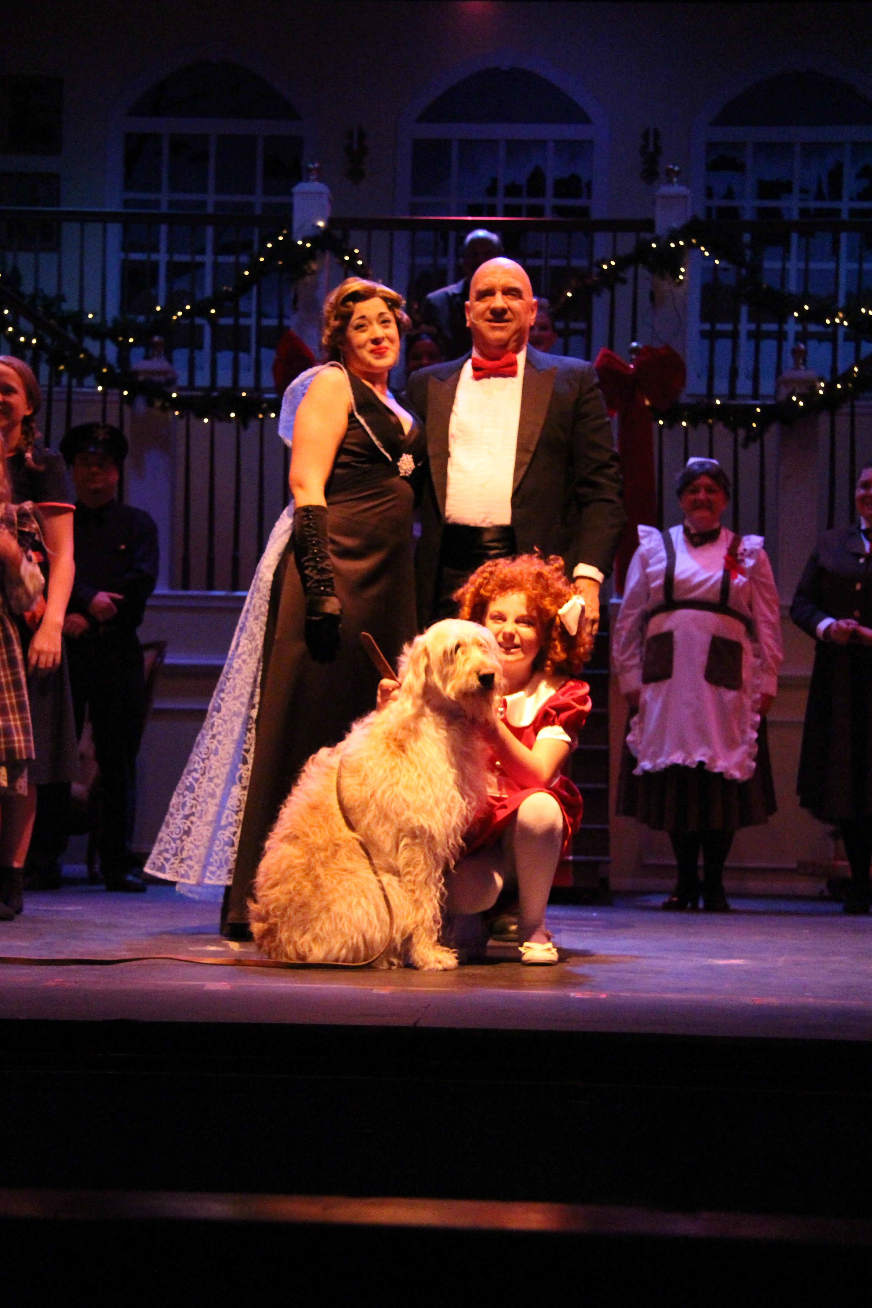 Annie, Sandy, Warbucks, and Grace. Photo by Laurie Mudd.