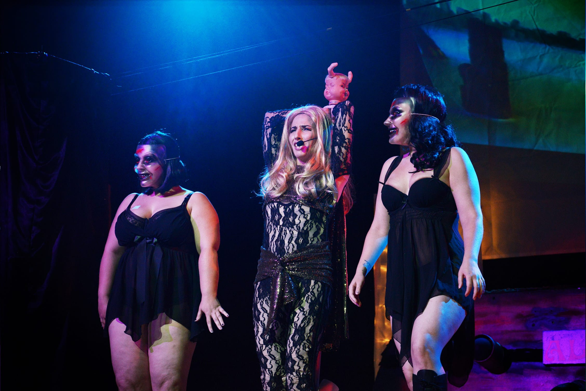Mourna Handful and Valeria Vox as evil dolls flanking Maria Bella as Barbarella. Photo by Aaron Barlow .