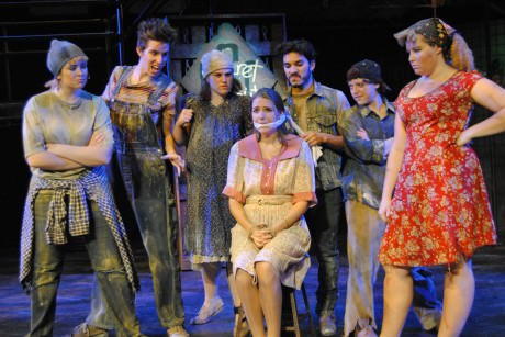 The cast of 'Urinetown the Musical.' Linday Martin (hope) is gagged and bound in the center. Photo by William Atkins, Senior University Photographer.