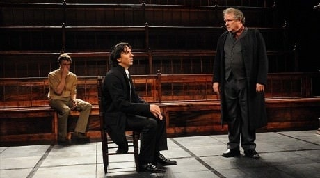 """Mortera (Michael Tolaydo), right, warns the young Spinoza (Alexander Strain) of the real possibility of excommunication. in '""""New Jerusalem: The Interrogation of Baruch de Spinoza."""" Photo by Stan Barouh."""