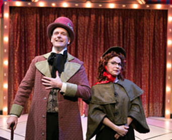 Peter Boyer (Scrooge)-Tracey Stephens (Charity Collector)