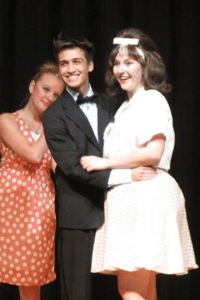 Isaac Solomon playing Link (center), Kaisa Nichols-Russell playing Tracy (right) and Magdalena Kowalska (left) playing Tammy in 'Hairspray.' Photo by  Diane Russell.