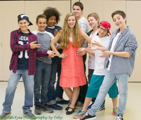 Kendra surrounded by the boys who adore her at middle school. Featuring (from left to right) Ryan Selig, Cole Sitilides, Winston Oughourli, Izzy Gaskill, Brett Hungar, Will Hemmingson, Alex Weinstein, and Cuinn Casey. Photo by Irish Eyes Photography by Toby.