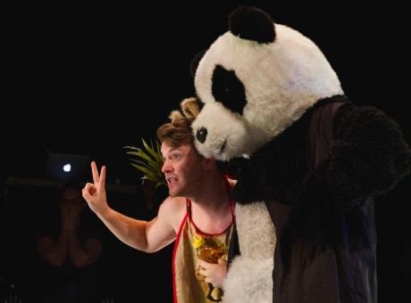Zachary Gilbert and a panda. Photo by Noe Todorovich Photography.