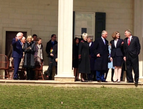 The Prince of Wales talks with Governor McAuliffe (at far right) and Carol Cardou (left of the Governor) – Camilla is seen on the left of the column with Mount Vernon's President Curt Viebranz.