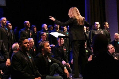 "Artistic Director Dr. Thea Kano conducting  during ""When You Wish.' Photo courtesy of Gay Men's Chorus of Washington."