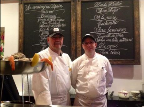 At the raw bar with Executive Chef Josu Zubikarai (left) and oyster shucker.