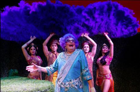 Dame Edna with giant purple ostrich fans. Photo by Craig Schwartz.