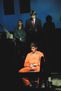 Dennis Shepard (Christophe Jelinski)  forgoes the death penalty for  Aaron McKinney (Faris Assaadi) as a jury Foreman (Leslie Jackson) observes. Photo by Paul R. Hogroian.