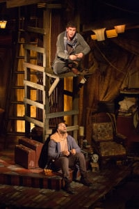 """This is not the first time we've spun coins."" Adam Wesley Brown (Guildenstern, top) and Romell Witherspoon (Rosencrantz) star in Rosencrantz and Guildenstern Are Dead. Photo by Jeff Malet."