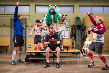 Zdenko Martin (Danny), Liam Forde (Luke), Jonathan Judge-Russo (Beardy Geoff), Michael Glenn (Joe), and Kimberly Gilbert (Viv) in 'Jumpers for Goalposts' at Studio Theatre. Photo by Igor Dmitry.