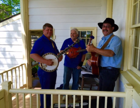 The Cobbler Mountain Grass band tunes up on the porch of Mt. Bleak House.