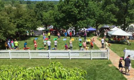 The spirited Corn Hole Tournament toss gets underway.