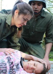 Israeli soldiers and a wounded Palestinian girl. Photo by Nada Serhan.