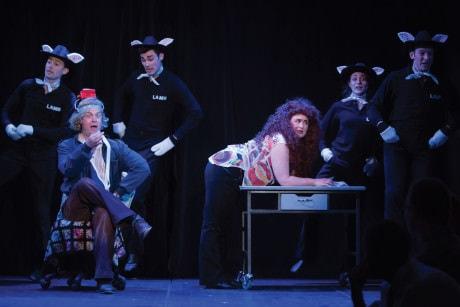 Tom Story (Buffalo Bill, Hayley Travers (Catherine), and the ensemble. Photo by Igor Dmitry.