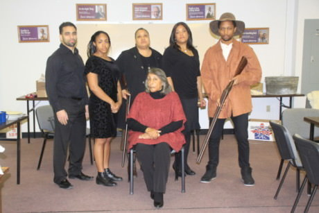 The cast: (L to R): Ben Harris (Frank Charles), Brawnlyn Blueitt (Minnie Dove), Kecia Campbell (Sophie Washington), Lolita Marie (Fannie Dove), and Darius McCall (Wil Parish). Seated: Sandra Cox True (Miss Leah). Photo courtesy of Bowie Community Theatre.