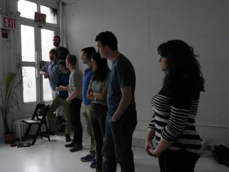 The cast and production team discuss the show. Photo courtesy of Critical Point Theatre.