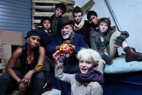 Jake Heston Miller (Oliver) (bottom center) with Eleasha Gamble (Nancy), Jeff McCarthy (Fagin), and members of Fagin's gang. Photo by Tony Powell.
