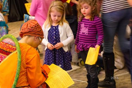 Children line up for autographs at Pumpkin Theatre after the show. Photo by Sean Berenholtz.
