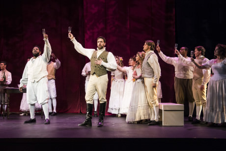 Daren Jackson, Anthony Eversole Don Giovanni toasts to the group at a party. Photo by Teresa Castracane.