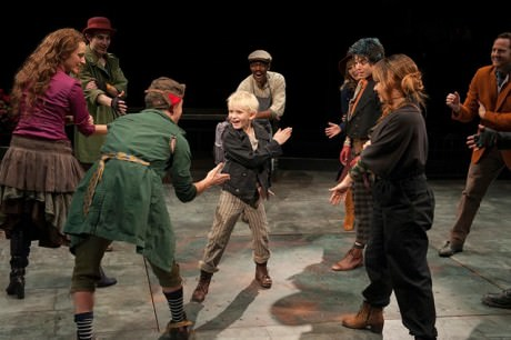 Jake Heston Miller (Oliver) and the company of Oliver! Photo by Margot Schulman.