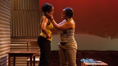 Aimé Donna Kelly (left) and Lynnette R. Freeman in InterAct Theatre Company's 'The Dangerous House of Pretty Mbane. Photo by Kate Raines/Plate3Photography.