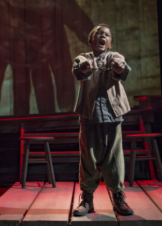 Jeremiah Hasty (Little Freddie) at the end of Act 1 of 'Uprising.' Photo by Chris Banks.