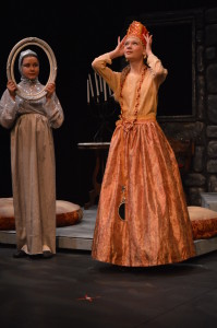 The Queen (Nadya Steare) asks the Magic Mirror (Ella McHugh) who is the fairest of them all. Photo by Larry McClemons.