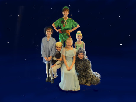From left to right: John Darling (Eli Langer), Michael Darling (Izzy Alexander) Peter Pan (Zoe Alexander), Wendy Darling (Madison Sherman), Tinker Bell (Alexa Vinner), and Nana (Josie Stein). Photo by photo by Laurie Levy Issembert.