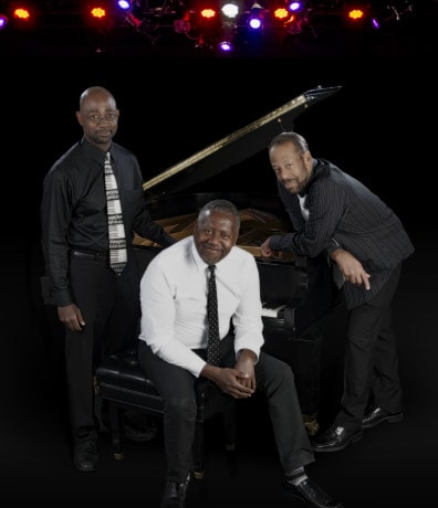 William Knowles, William Hubbard, and Thomas W. Jones II at the piano. Photo by Chris Banks.