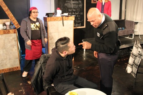 Chris Peralta (Andrew Quilpa) looks on as Ryan Park (Smitty Chai) is rebuked by Officer Frank Bell (Christopher Holbert) for his aggressive behavior. Photo by Sarah Scott.