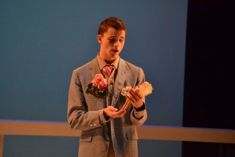 Giuliano (David Brewer) with one of his many Barbie dolls. Photo by Emily Pound.