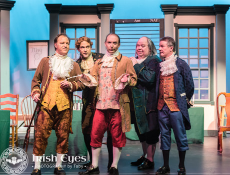 John Adams of Massachusetts (Brent Stone), Thomas Jefferson of Virginia (Scott Gustaveson), Robert Livingston of New York (James Maxted), Ben Franklin of Pennsylvania (Jeff Westlake), and Roger Sherman of Connecticut (Jerry Hoffman) decide that Thomas Jefferson is the best person to write the declaration on independence. Photo by Irish Eyes Photography by Toby.