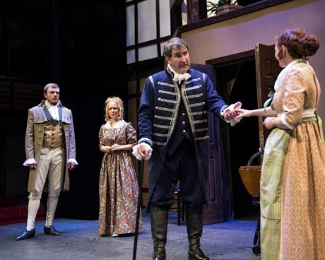 "In her home, the Quaker Lady Amaranth (Lizzi Albert) and others (Elliott Kashner and Robby Rose) rehearse Shakespeare's "" 'As You Like It' despite vigorous objections from Quaker Ephraim Smooth (Gregory Burgess). Photo by Teresa Castracane."